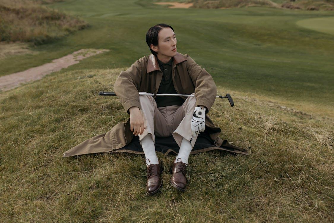 A Golfer Sitting on the Grass
