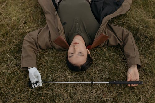 A Golfer Lying on the Grass