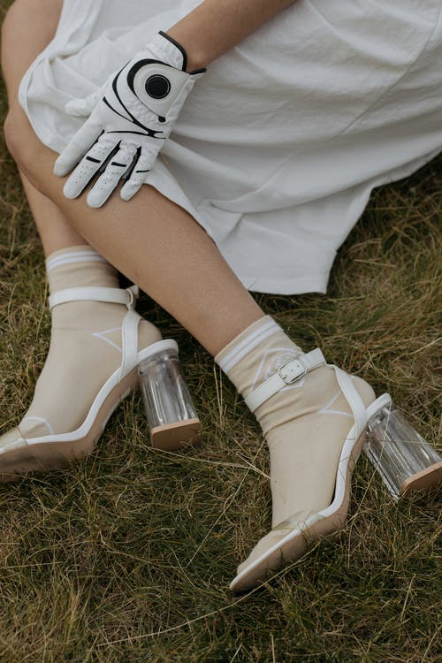 Person Wearing White Leather Shoes
