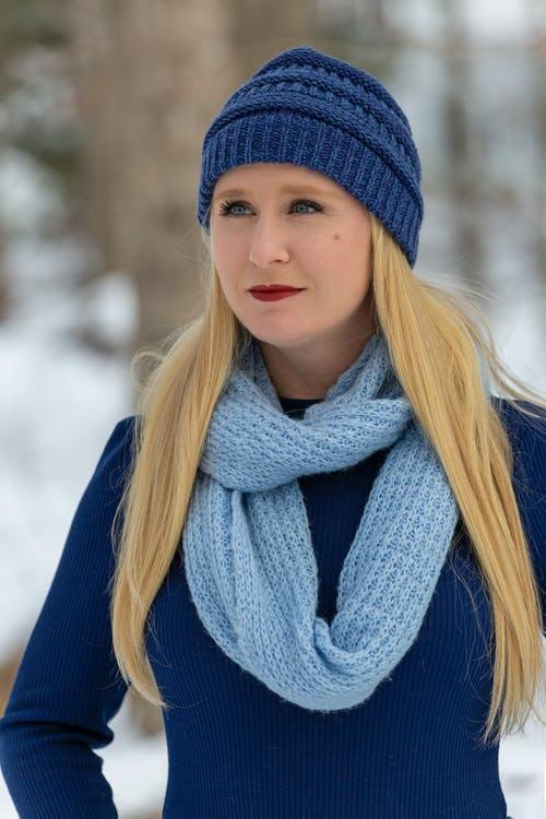Woman in Blue Knit Cap and Blue Scarf