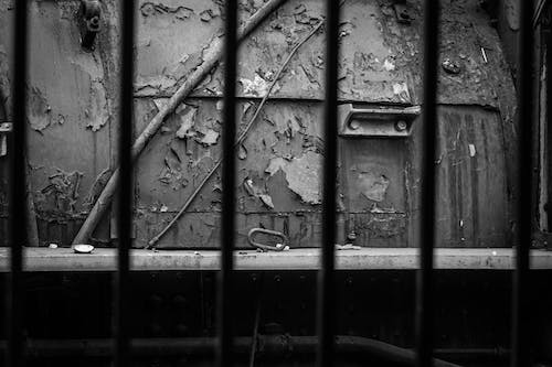 Free stock photo of behind bars, black and white, train