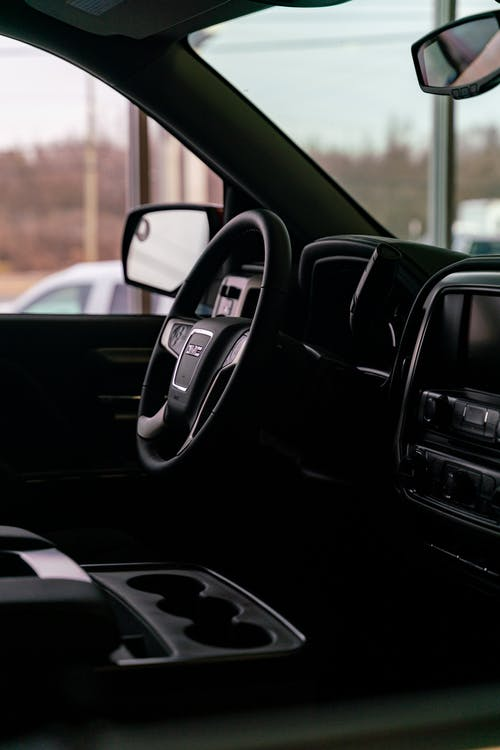 Black Car Door With Black Steering Wheel