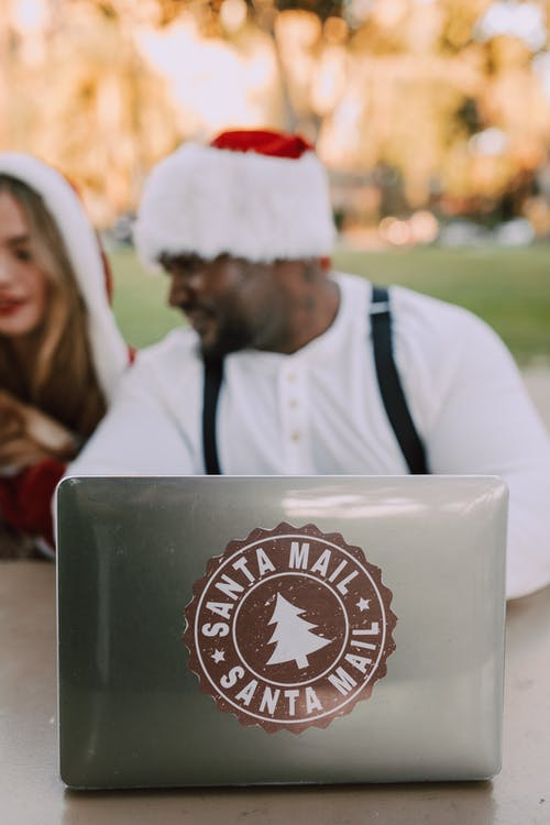 Blur Photo Of Man And Woman In Santa Outfit