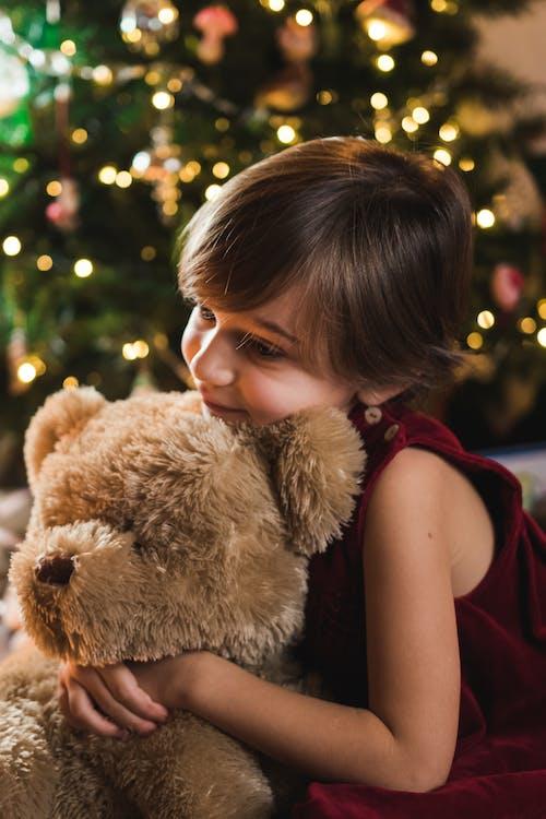 Girl in Black Tank Top Hugging Brown Teddy Bear