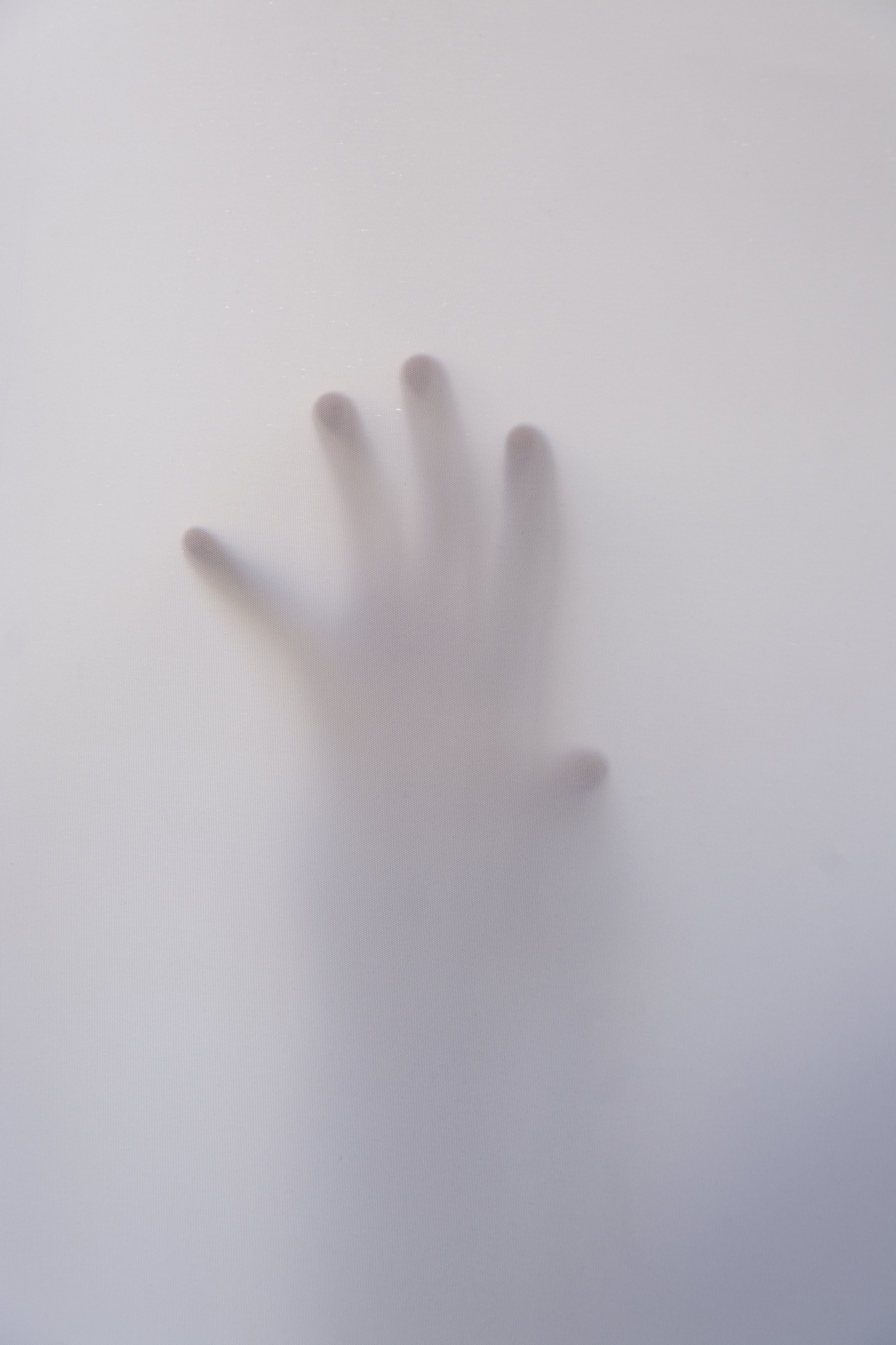 Person's Hand Touching Wall