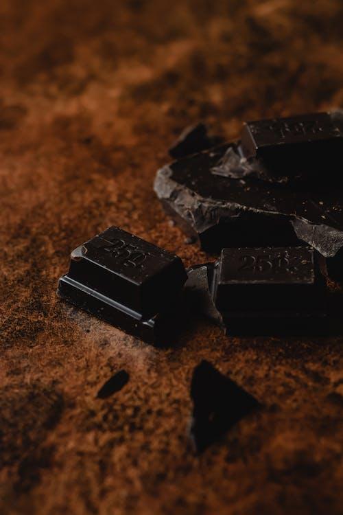 Black Chocolate Bar on Brown Sand