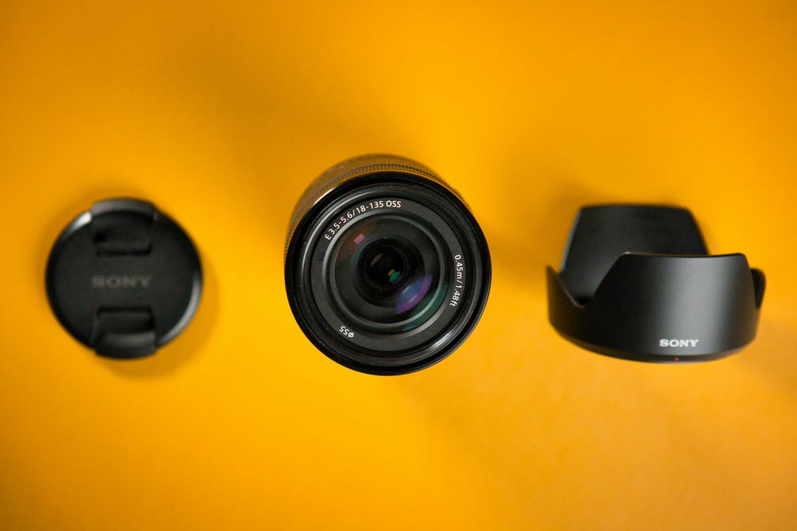 Black Camera Lens on Yellow Surface