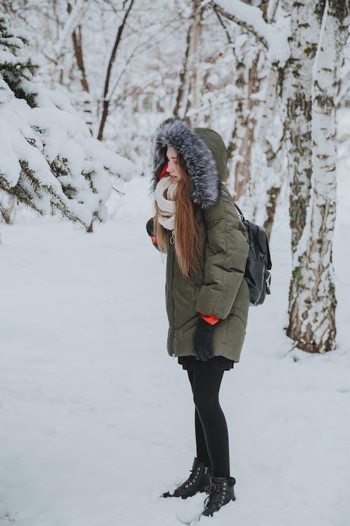 Woman in outwear o in forest