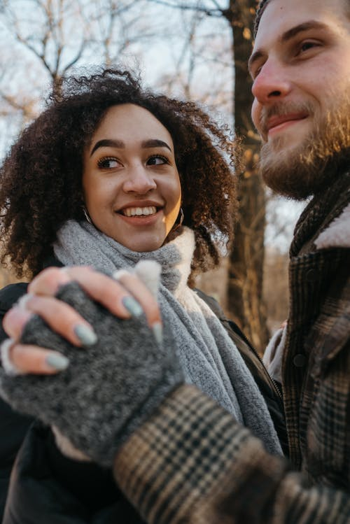 Man and Woman Smiling While Holding Hands
