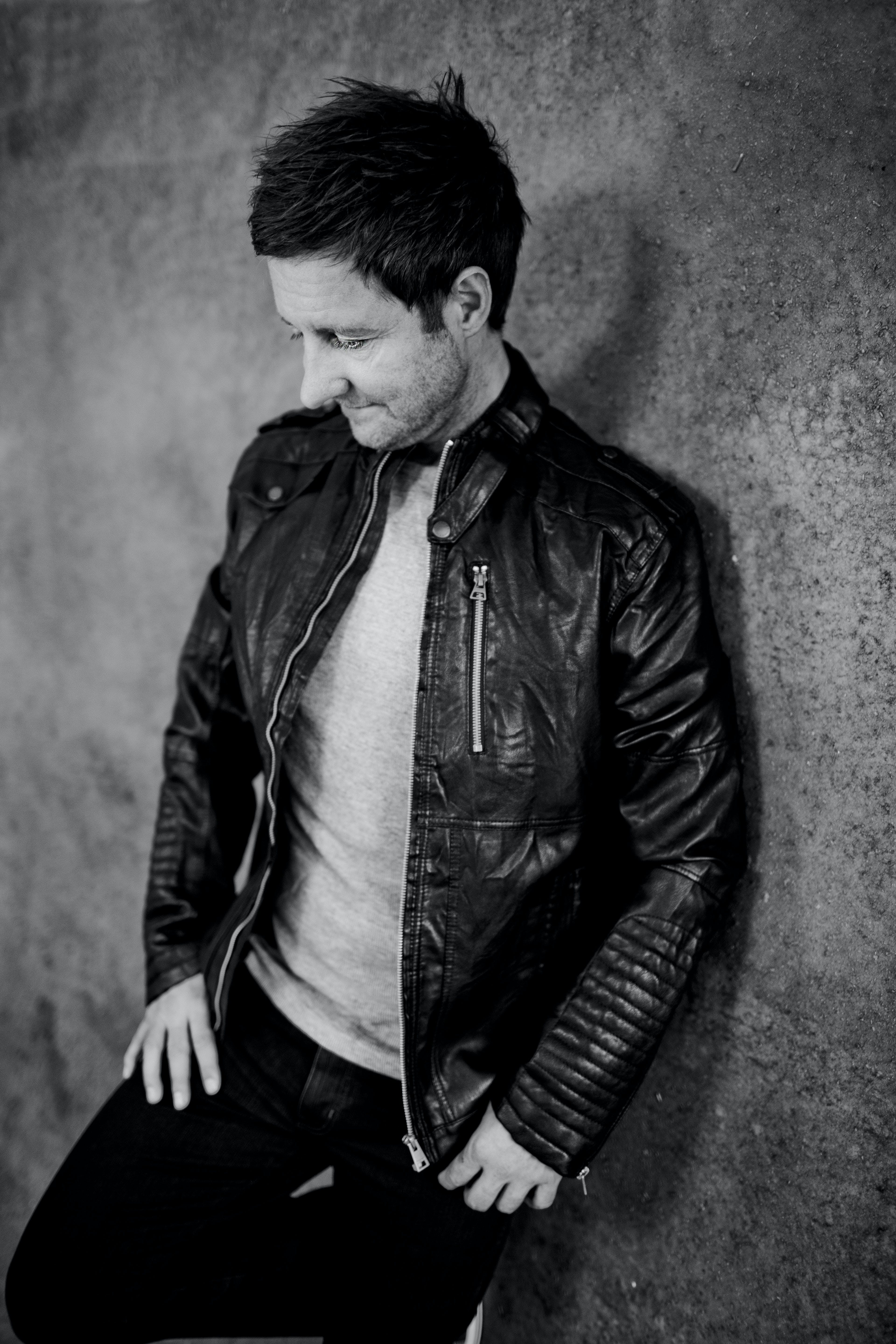 Grayscale Photo of Man Wearing Black Leather Full-zip Jacket