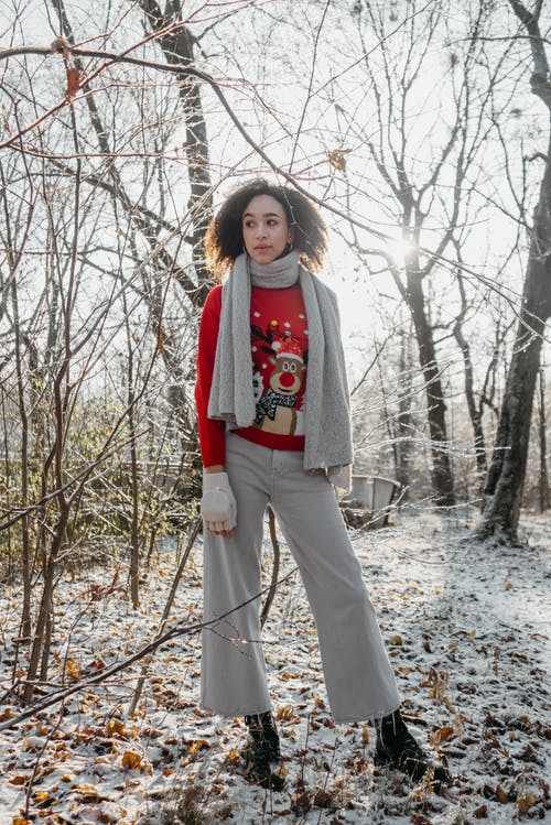 Curly Haired Woman In Red Christmas Sweater