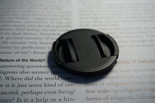 Free stock photo of book pages, camera, camera equipment, camera lens