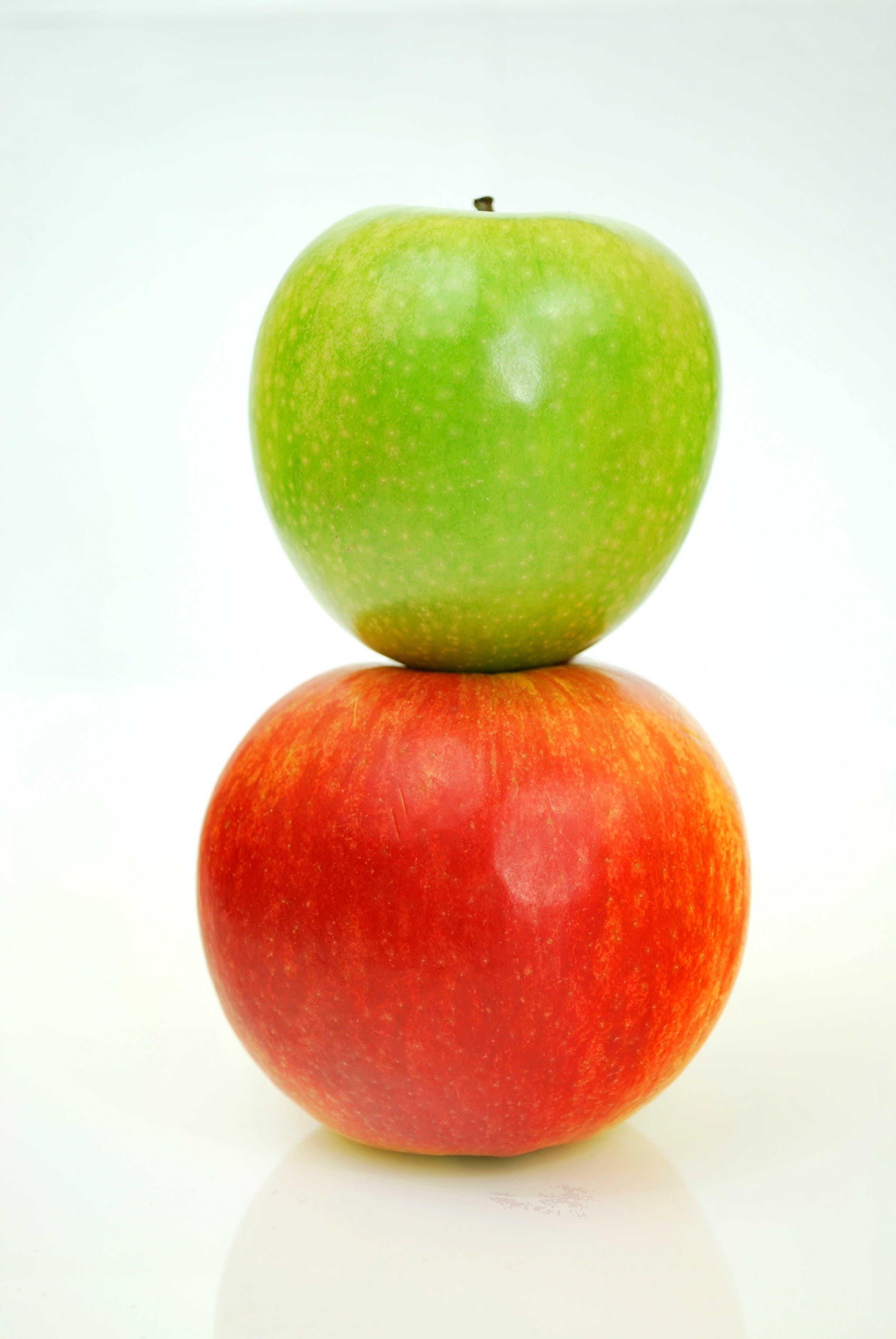 Green Apple Fruit at the Top of Red Apple Fruit