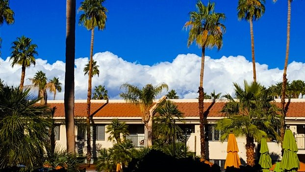 Free stock photo of clouds, hotel, trees, house