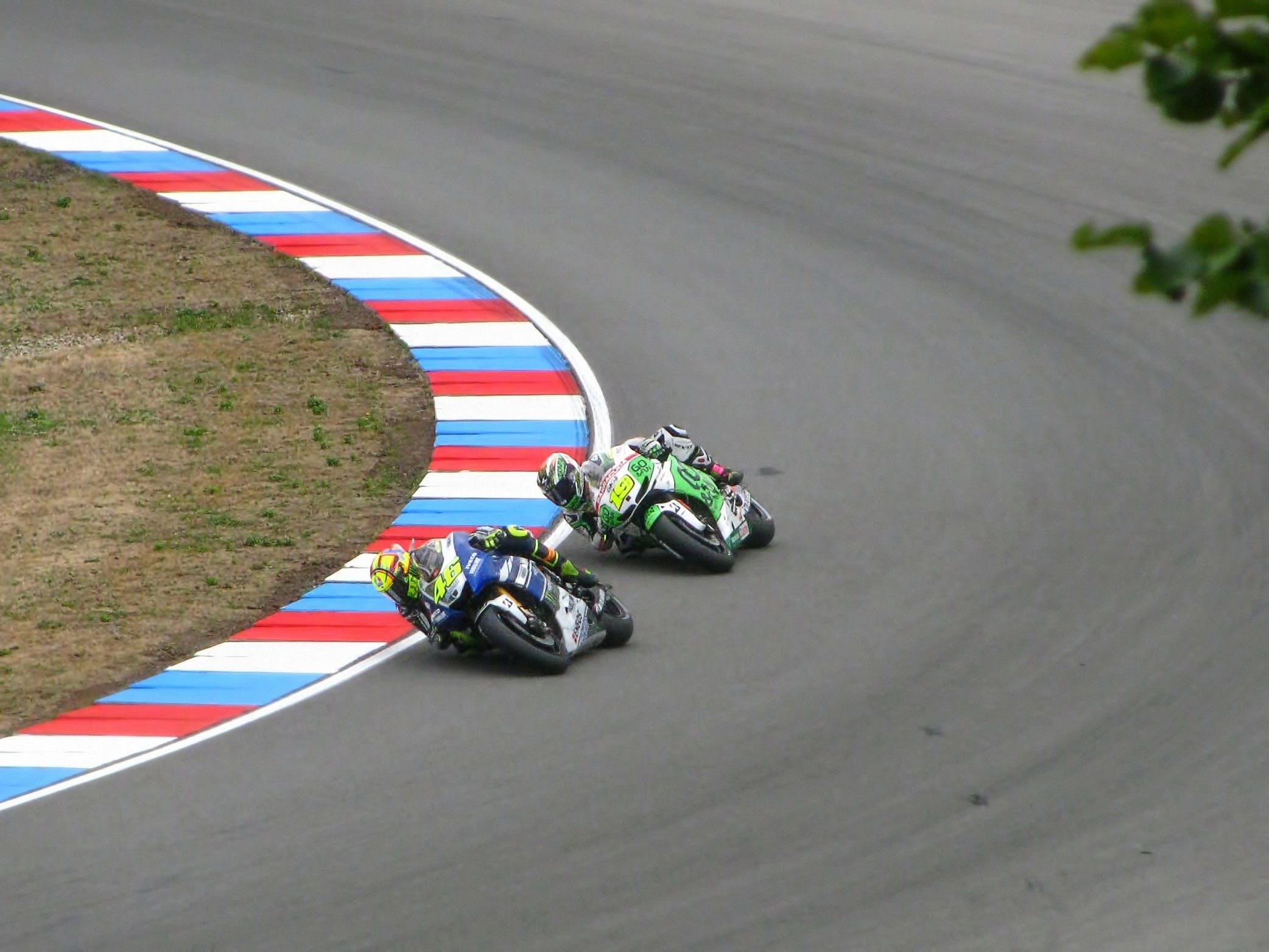 Racing Between 2 Men Riding Motorcycle