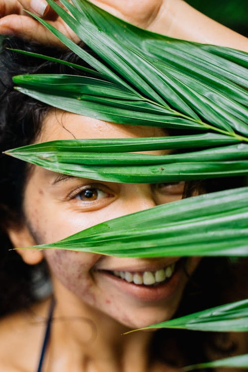Woman With Green Leaves on Her Face