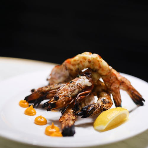 Delicious seafood dish served with lemon and sauce