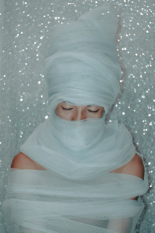 Woman in White Hijab Standing Near White Wall