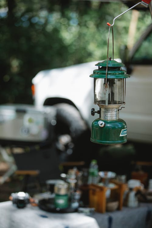 Retro lantern placed in car camping