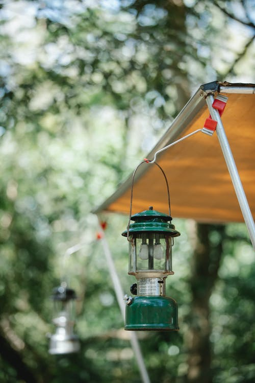 Vintage lantern hanging on awning in woods