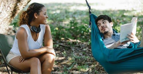 Joyful multiethnic couple talking to each other