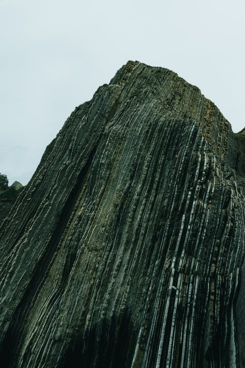 Steep rough rocky formation in mountainous terrain