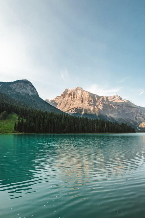Peaceful water of rippling lake surrounded with mountains