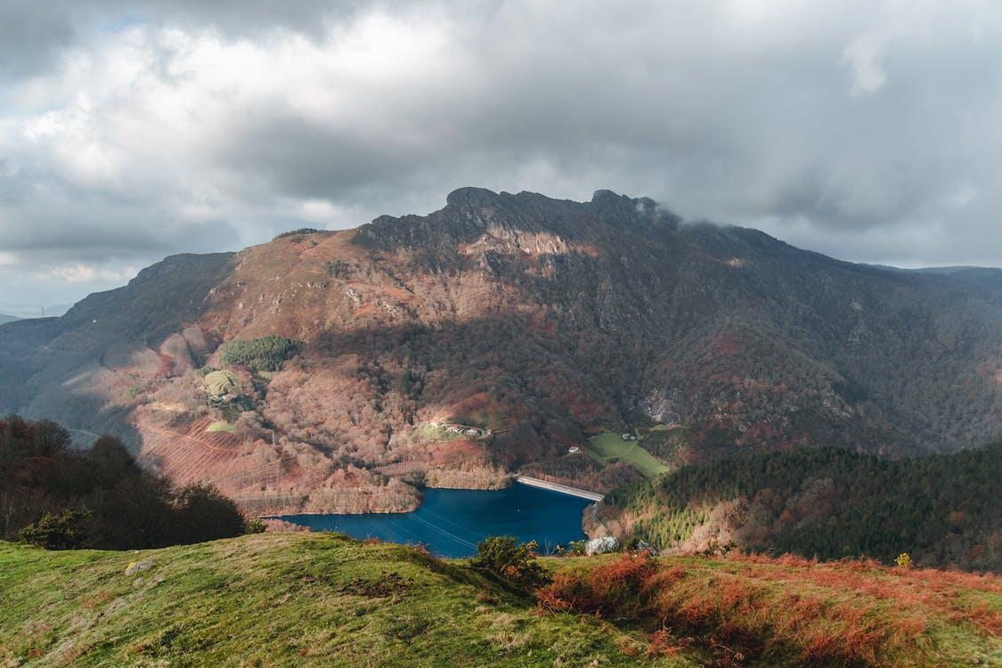 Calm blue lake in mountainous terrain