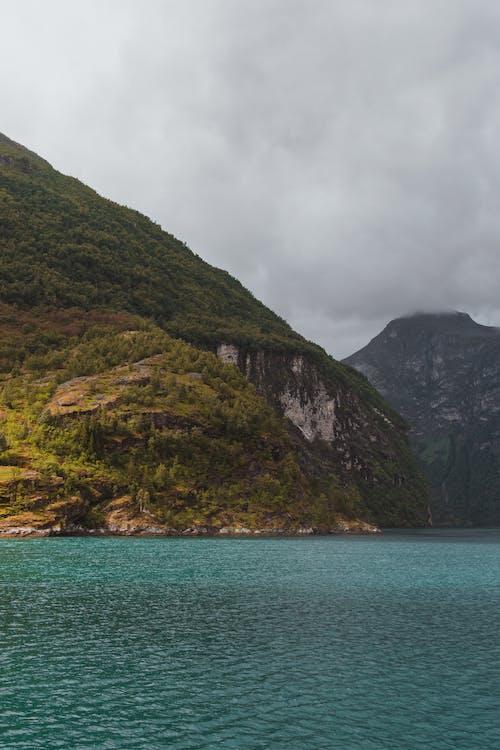 Rippling sea water near rocky mountain