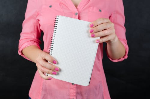 Person Holding White Graphing Paper