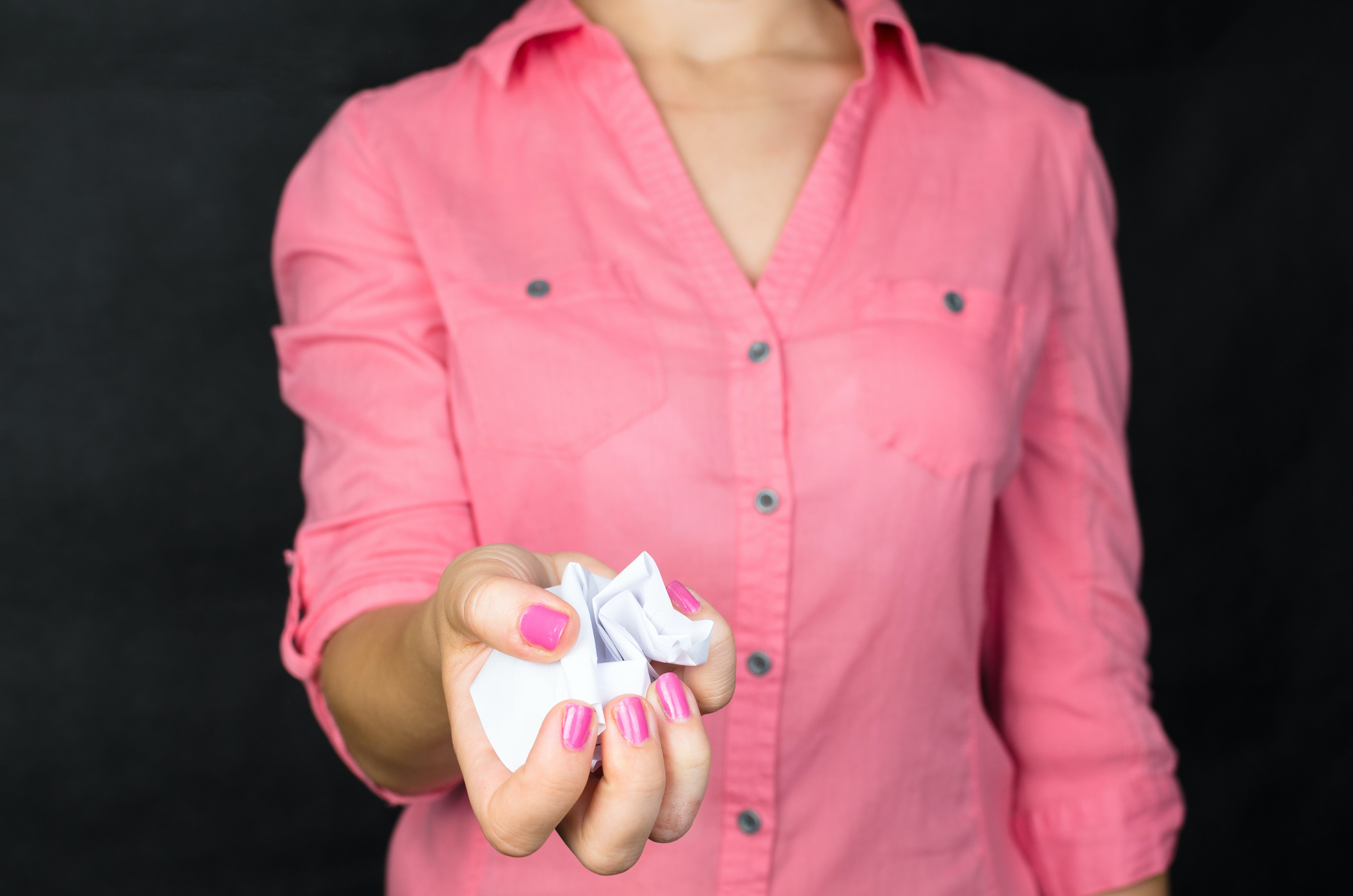 Woman Holding Crumpled Paper