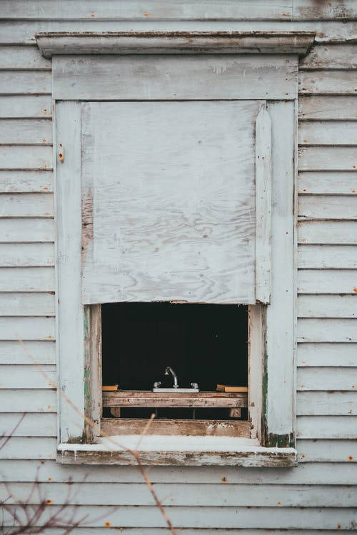 Wooden window of aged house