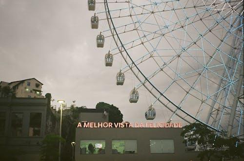 Cityscape with Ferris wheel near modern buildings