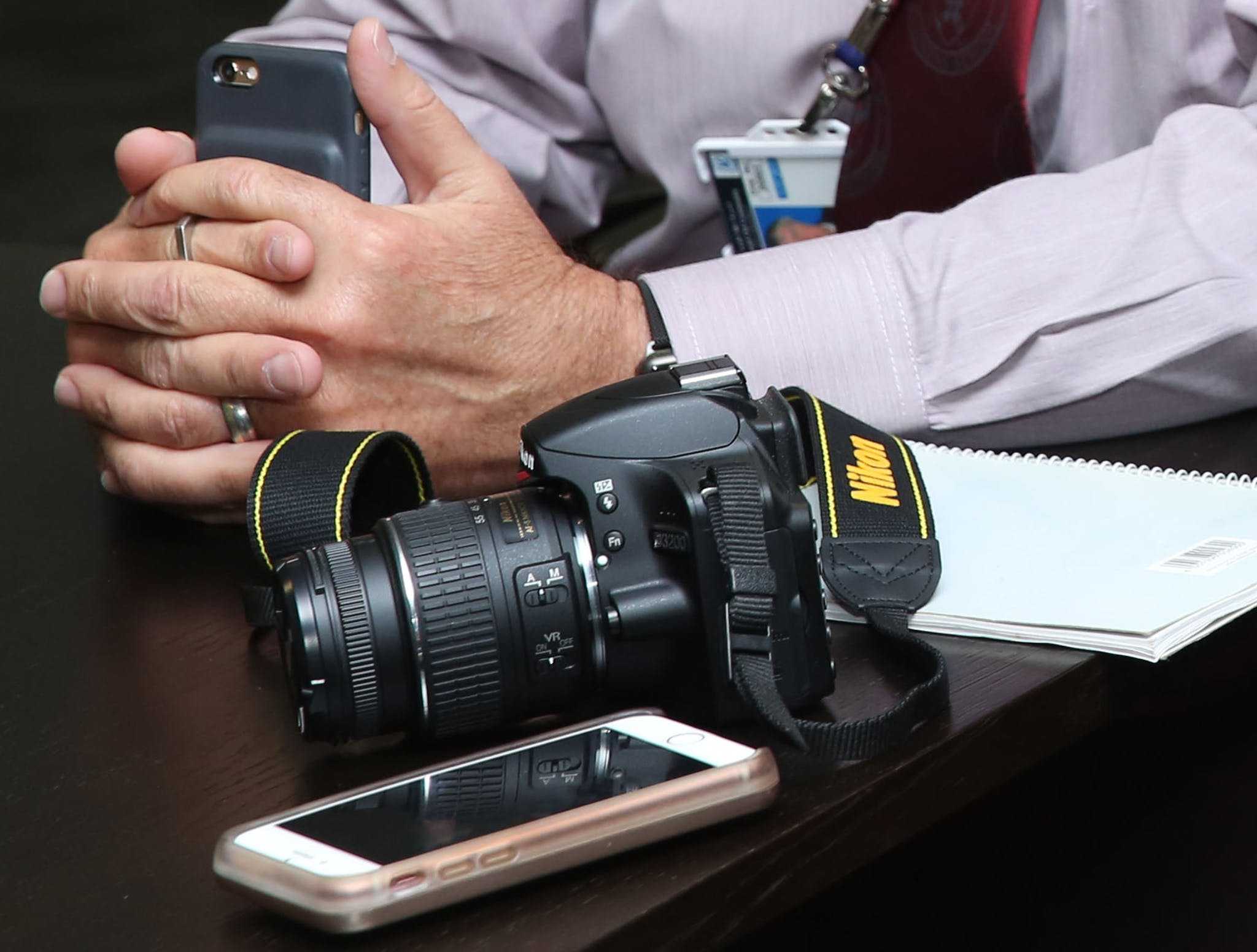 Black Nikon Dslr Camera Beside Person's Hands