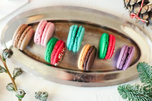 Delicious macaroons served on steel tray
