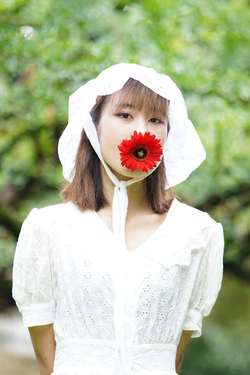 Woman in White Dress Wearing Red Flower Headband