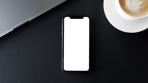 Mobile Device on Black Surface