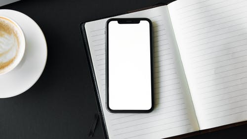 Mobile Phone on Top of Stationery
