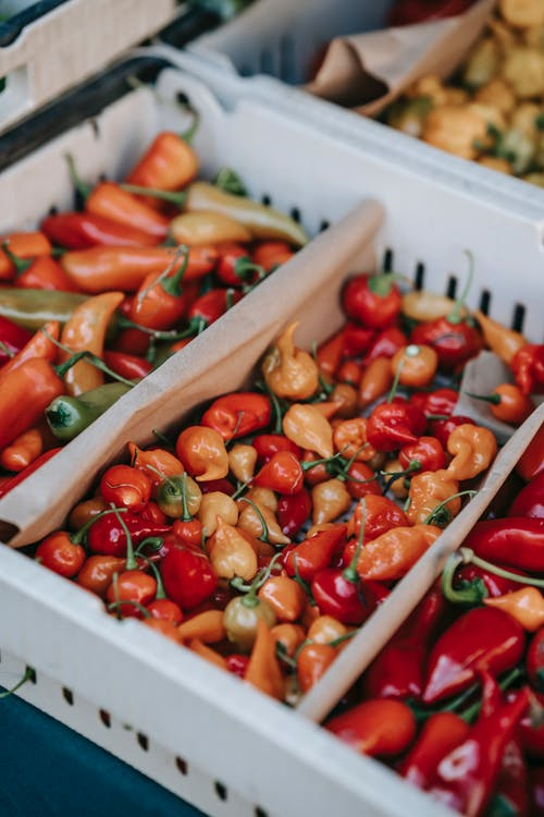 Stall with ripe capsicums in supermarket