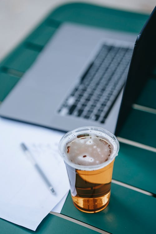 Table with laptop and glass of beer