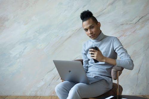 Serious black student using laptop for studies