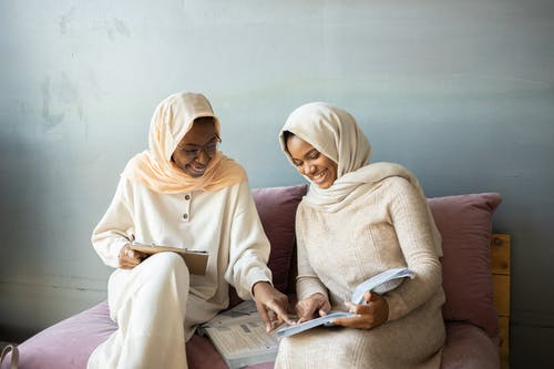 Woman in White Hijab Reading Book