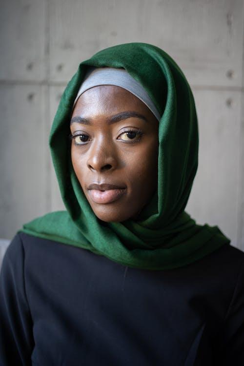 Islamic African American female in hijab near wall