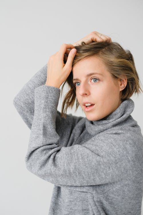 Woman in Gray Turtleneck Sweater