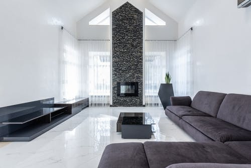 Spacious living room with soft comfy couch and minimalist furniture