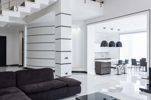 Modern furniture in spacious living room and kitchen