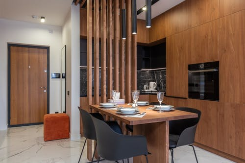Table setting in modern kitchen with wooden furniture