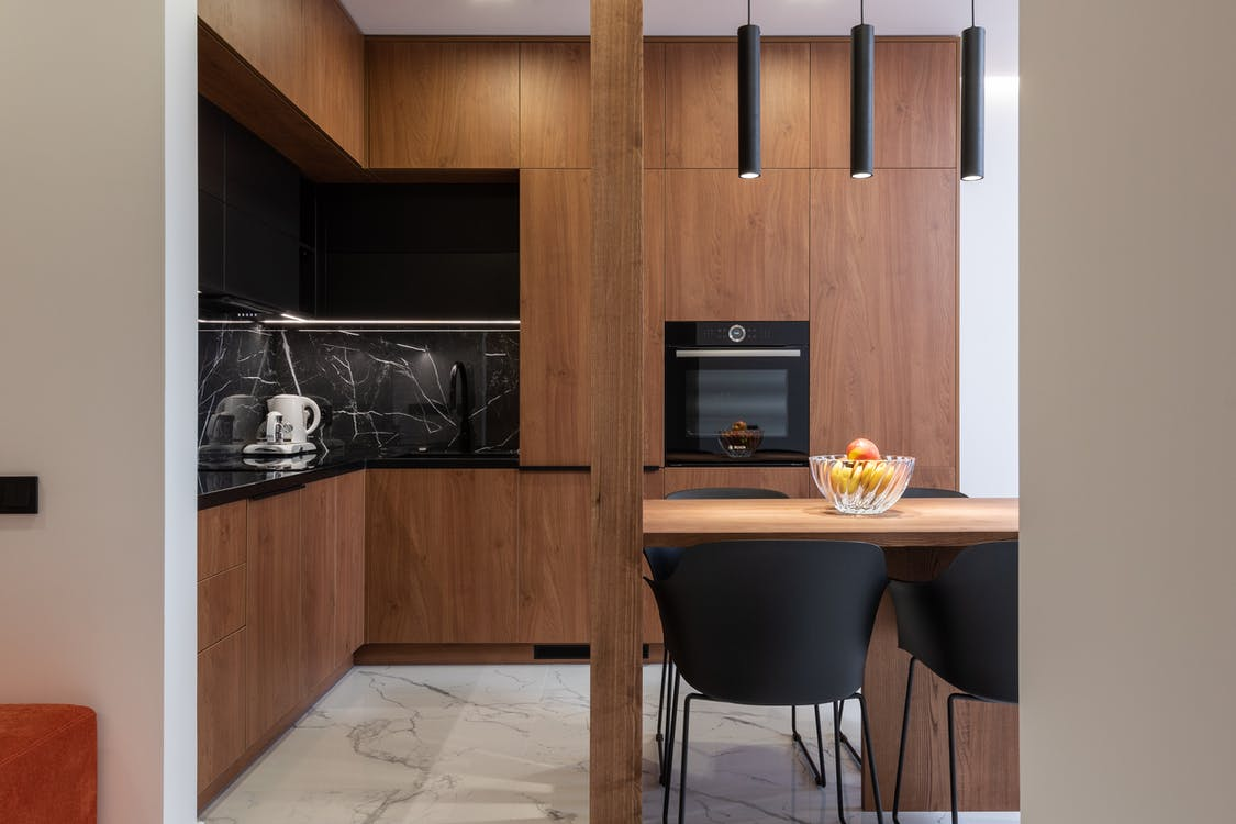 Wooden furniture and table in contemporary kitchen with dining zone