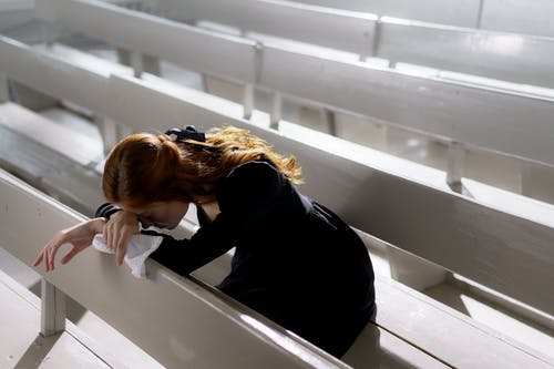 Woman in Black Long Sleeve Shirt Using Binoculars