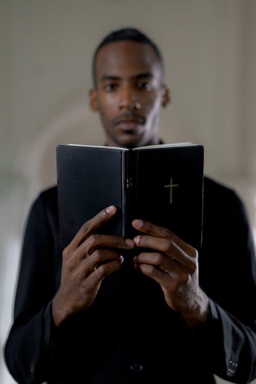 Man in Black Suit Holding Black Tablet Computer
